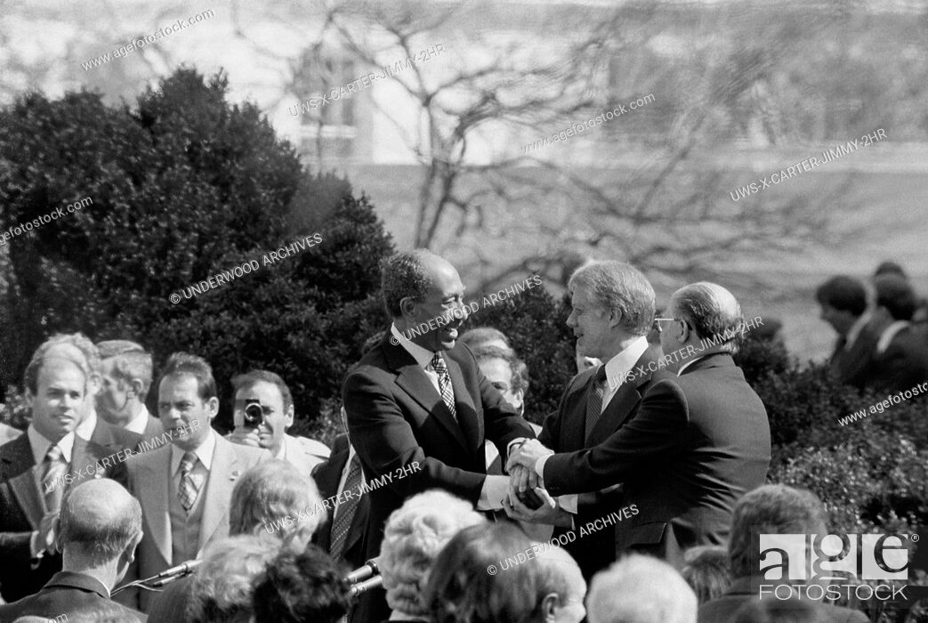 Stock Photo: Washington, D. C. : March 26, 1979. President Jimmy Carter shaking hands with Egyptian President Anwar Sadat and Israeli Prime Minister Menachem Begin at the.