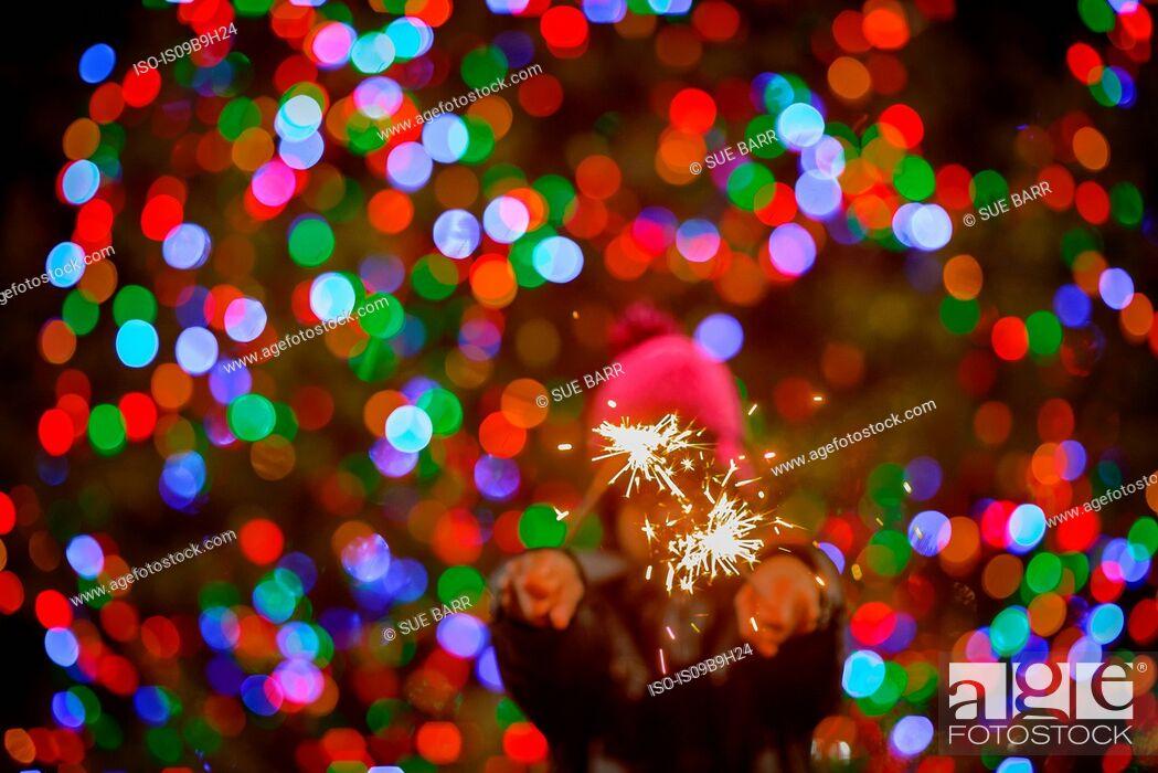 Stock Photo: Teenage boy holding sparklers.