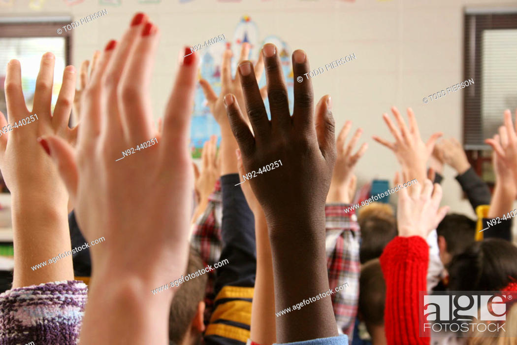 Stock Photo: hands in air shot at public school in suburb of Chicago, Illinois. USA.