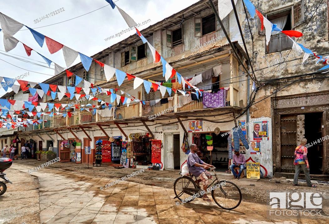 Stock Photo: Street scene with typical buildings in Stone Town, Zanzibar, Tanzania, Africa.