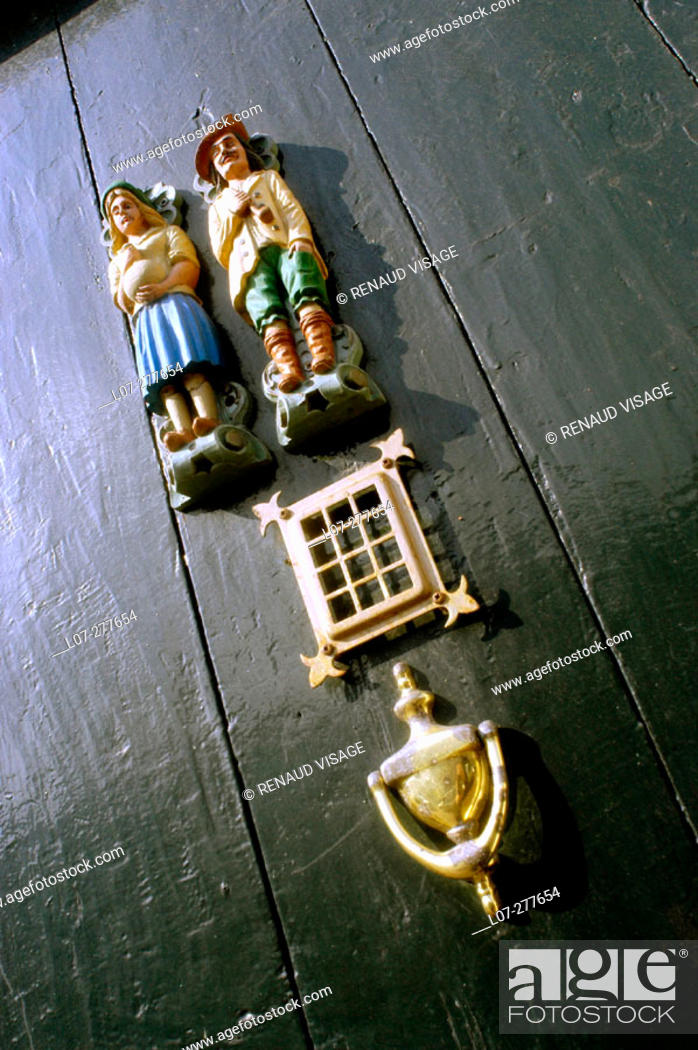 Stock Photo: Dutch figurines and knocker on house door. Amsterdam. Holland.