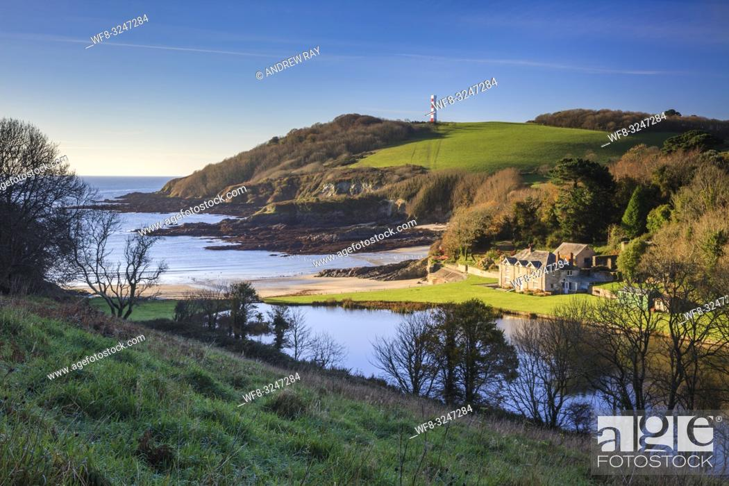 Stock Photo: Polridmouth Cove near Fowey in Cornwall, captured from a high vantage point on a morning in mid November with the navigation aid on Gribbin Head in the distance.