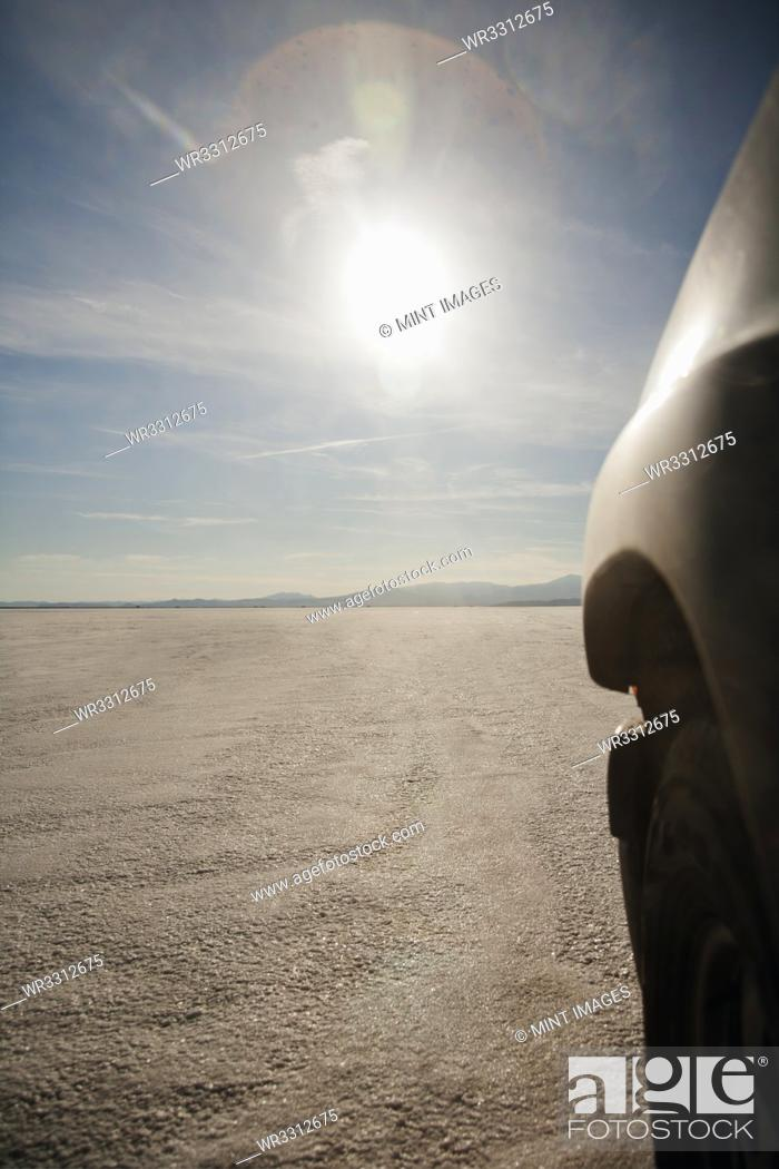 Stock Photo: Close up of car driving on salt flats, Bonnaville Salt Flats, Utah, United States.