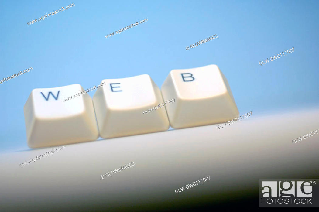 Stock Photo: Close-up of computer keys spelling the word web.