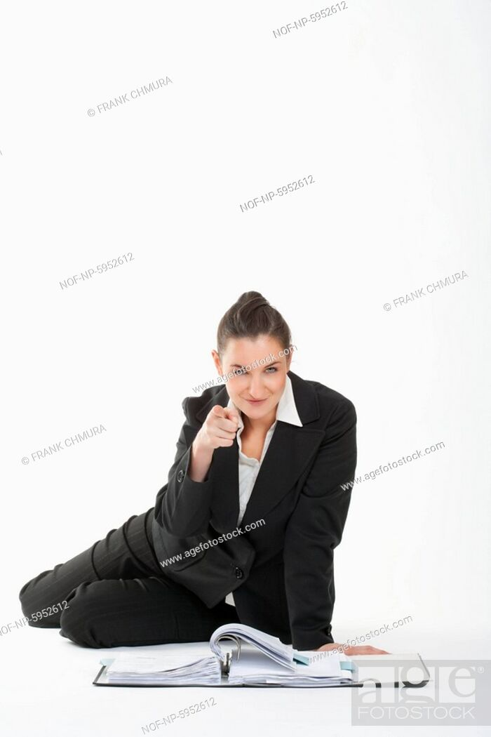 Stock Photo: Businesswoman in suit pointing at the camera.