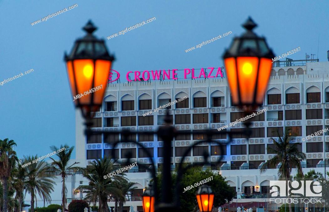 Stock Photo: Arabia, Arabian peninsula, Sultanate of Oman, Muscat, Qurum, 'Liebesstrasse' Ash Shati Street, Crowne plaza Hptel, street lamps, in the evening.