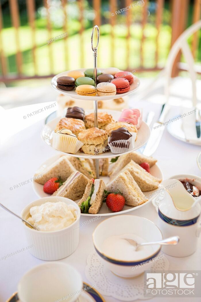 Stock Photo: Cake stand with sandwiches, cookies and macaroons.