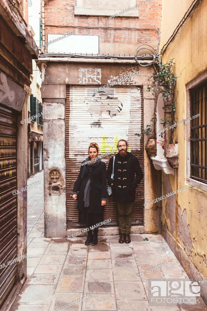 Stock Photo: Portrait of couple on street, Venice, Italy.