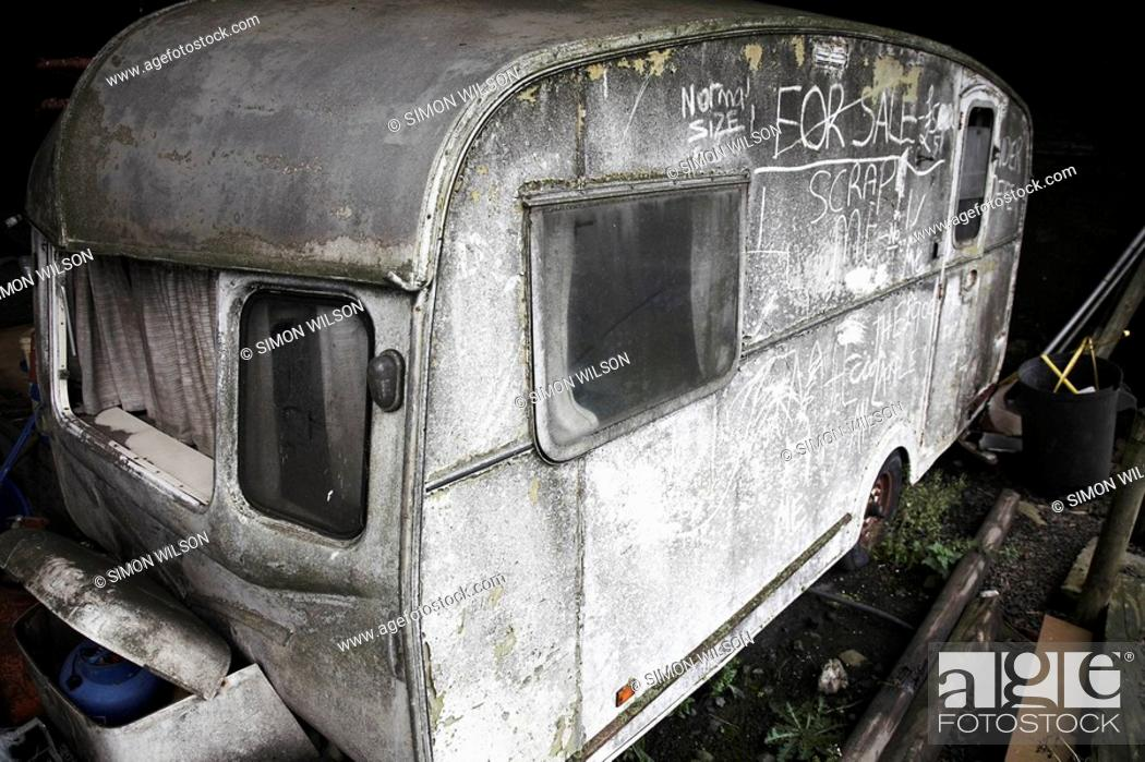 Stock Photo: Dirty old neglected caravan.