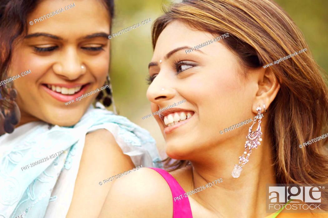 Stock Photo: Close-up of two young women back to back.