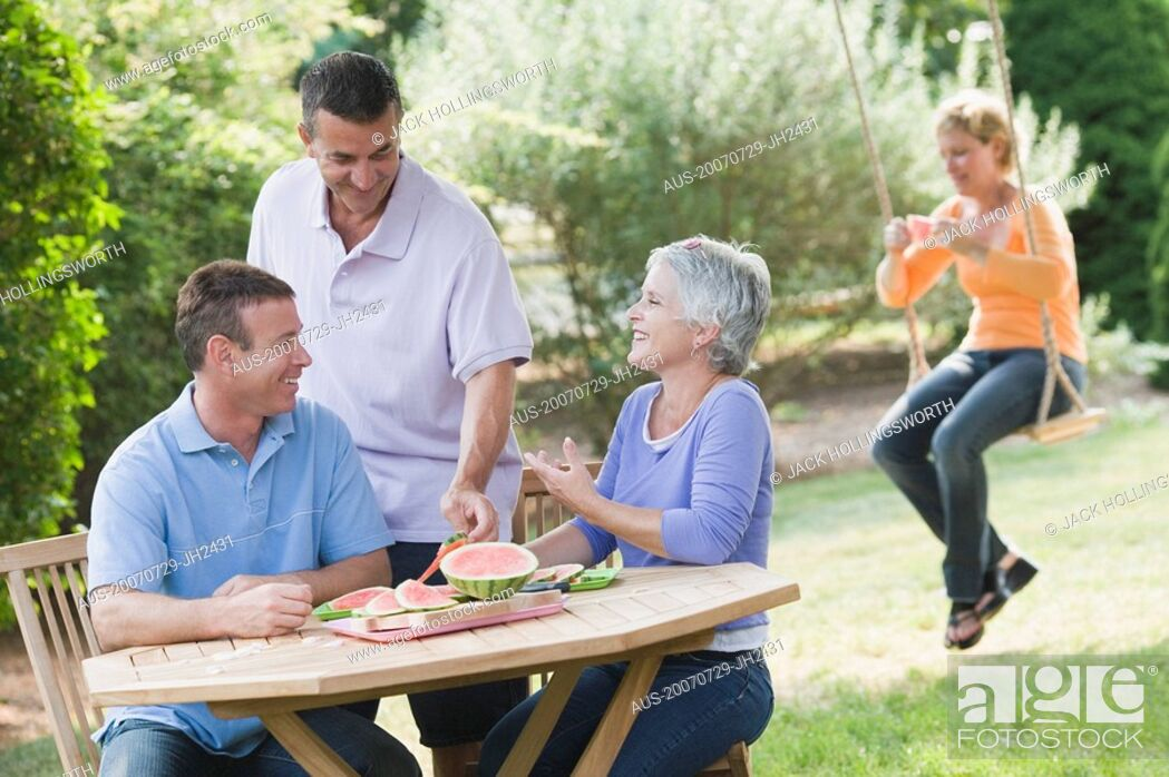 Stock Photo: Two mature couples in a lawn.