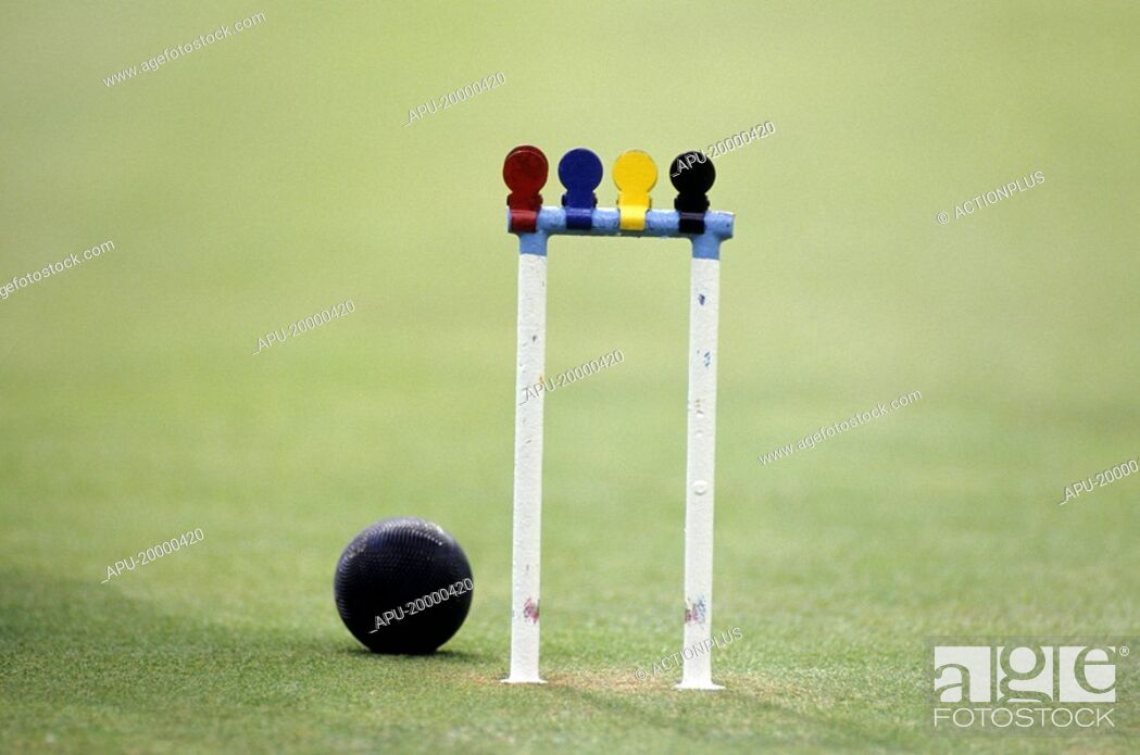 Stock Photo: Croquet ball and hoop with markers.