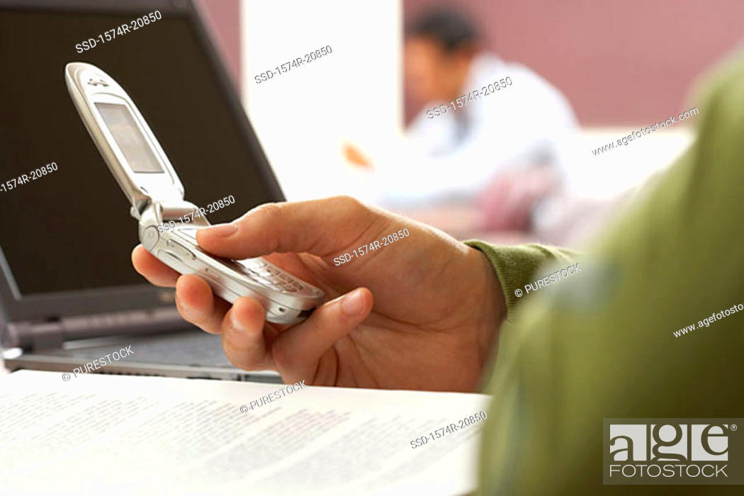 Stock Photo: Close-up of a person's hand using a mobile phone.