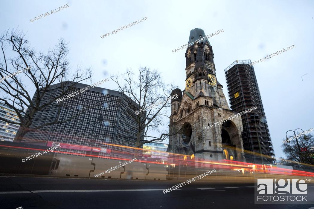 Stock Photo: 11 February 2020, Berlin: The Kaiser-Wilhelm-Gedächtnis-Kirche can be seen in the early evening, whereby the traffic leaves light tracks.