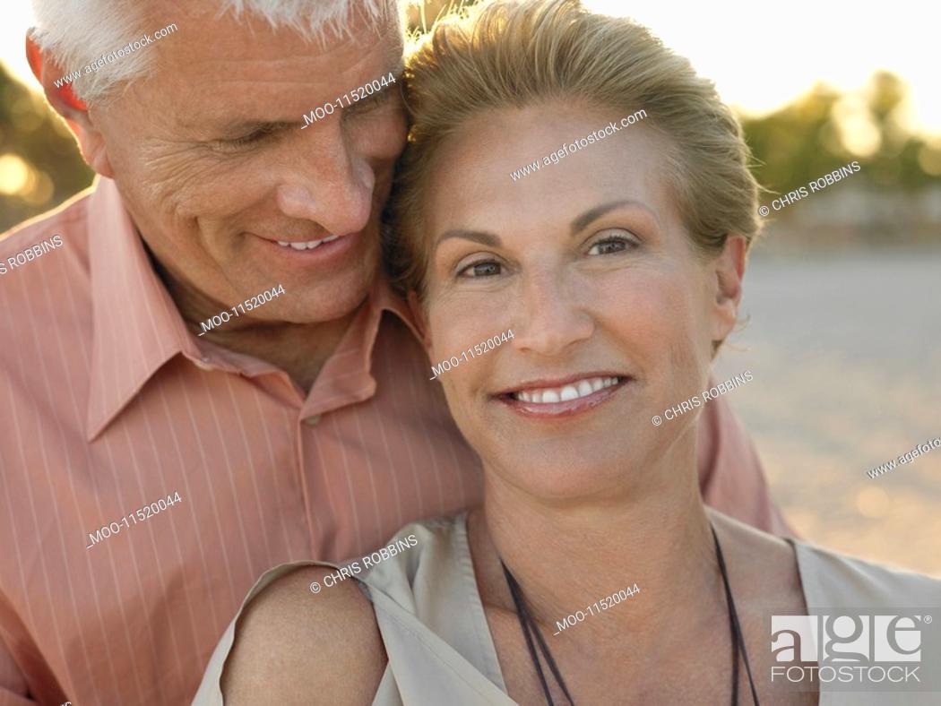 Stock Photo: Smiled senior couple on tropical beach close up.
