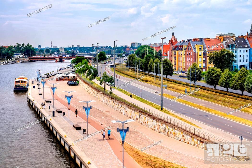 Stock Photo: Piastowski Boulevard on Odra River embankment with ships converted to restaurants. People walking and relaxing on river bank in old town quey.