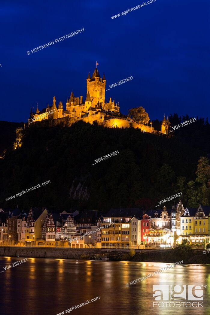 Stock Photo: The beautiful Reichsburg Cochem (Cochem Imperial Castle) with village and the river Moselle in the foreground at night, Cochem, Rhineland-Palatinate, Germany.