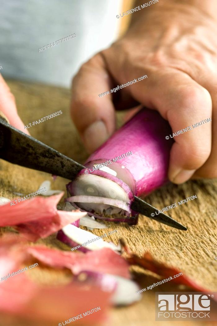 Stock Photo: Slicing red onion.
