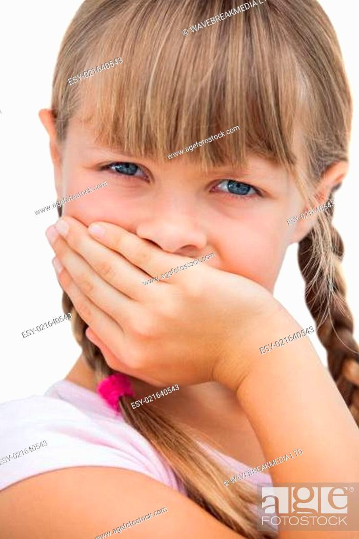 Stock Photo: Beautiful little girl with her hand on her mouth.