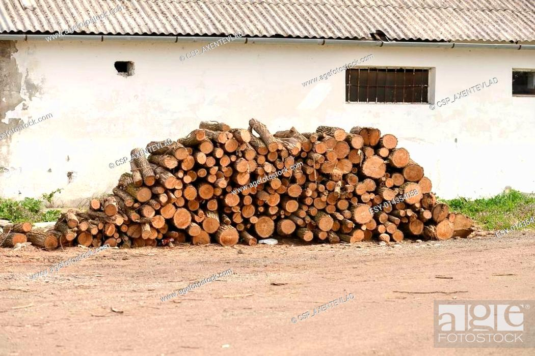 Outstanding Pile Of Woods Near The Wall Of The Old House Stock Photo Download Free Architecture Designs Embacsunscenecom