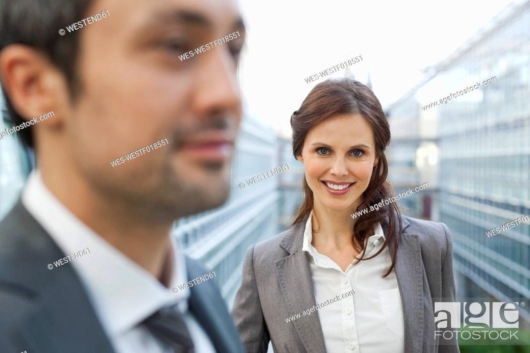 Stock Photo: Germany, Leipzig, Business people smiling.