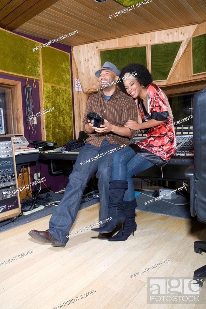 Stock Photo: Producer and musician in recording studio.