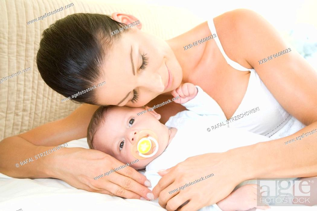 Stock Photo: Mother and baby laying in bed.