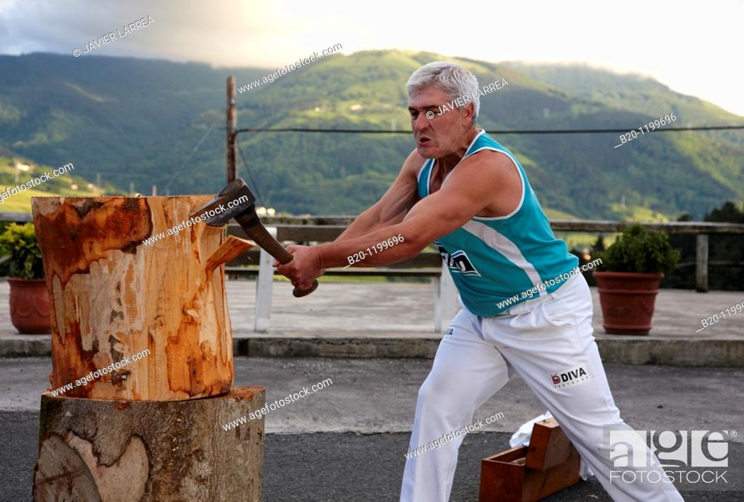 Stock Photo: Luis Txapartegi, Aizkolari (wood-chopping), Basque rural sport, Aduna, Gipuzkoa, Basque Country, Spain.