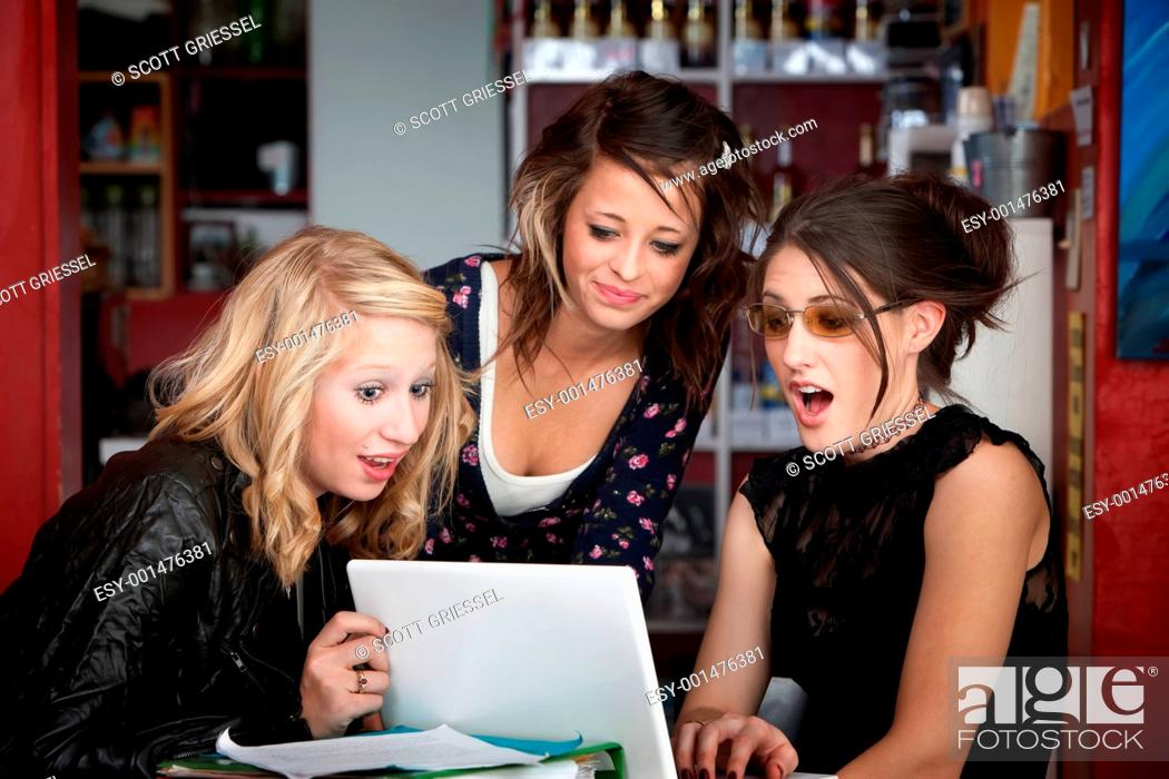 Stock Photo: Surprised Girls Looking at a Laptop.