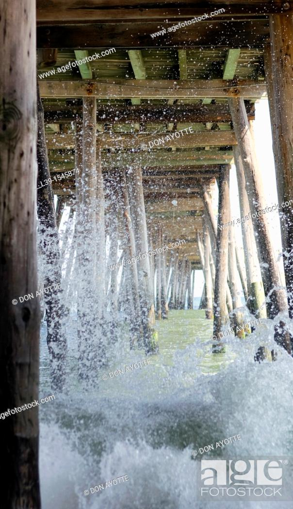 Stock Photo: raging surf under the pier in Kill Devil Hills, NC, USA.