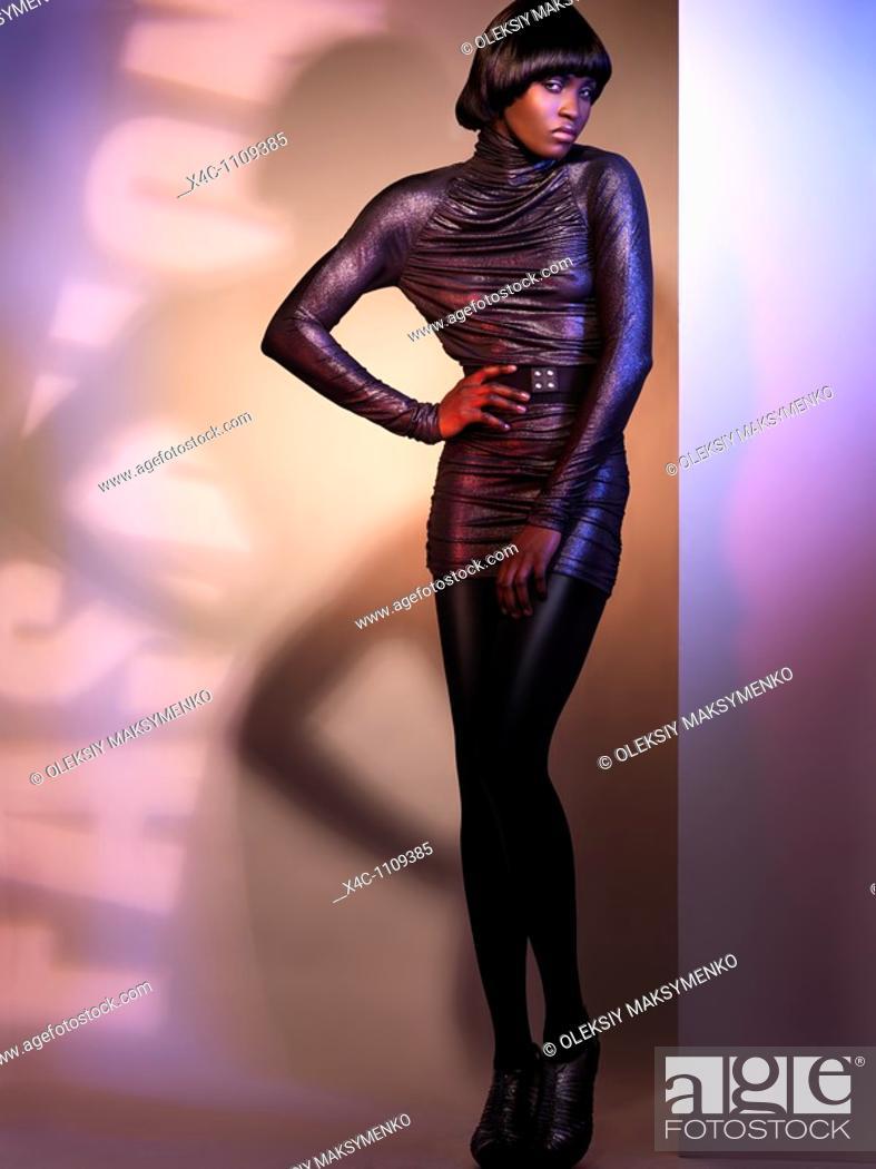 Stock Photo: Beautiful young woman high fashion model posing in studio settings.