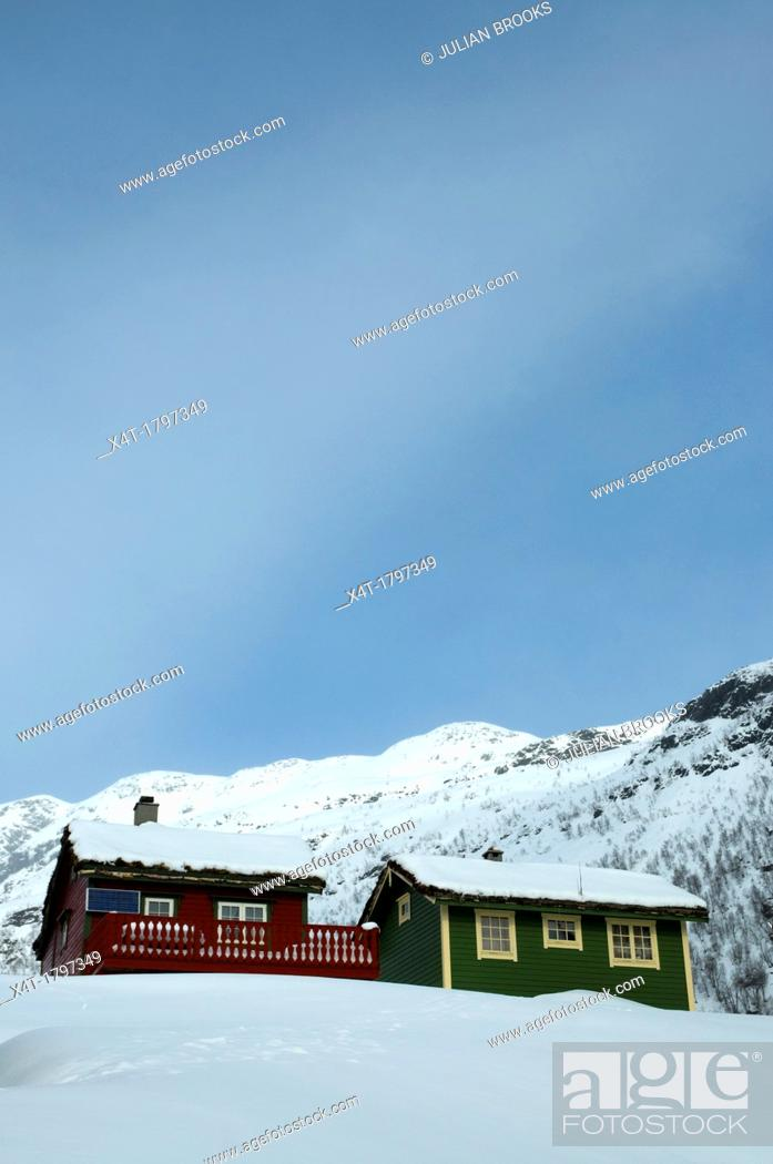 Stock Photo: typical mountain huts in Norway  Sun and snow,.