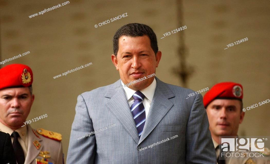 Stock Photo: Venezuela's President Hugo Chavez salutes to journalists in Miraflores Palace in Caracas, Venezuela.