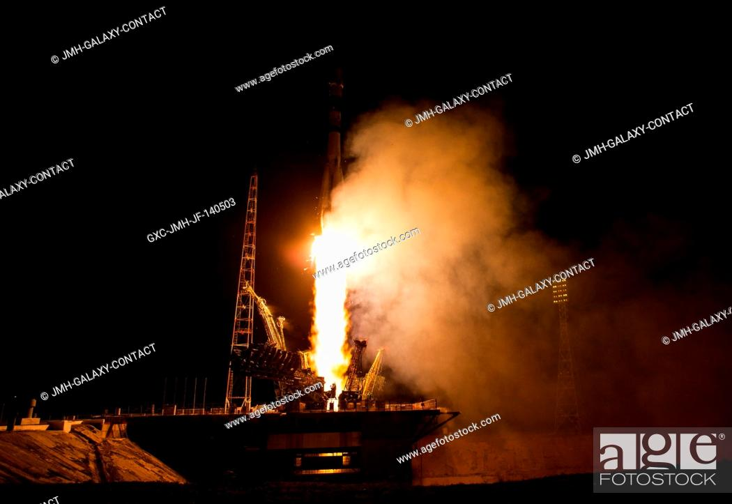 Stock Photo: The Soyuz TMA-13M rocket is launched with Expedition 40 Soyuz Commander Maxim Suraev of the Russian Federal Space Agency (Roscosmos).
