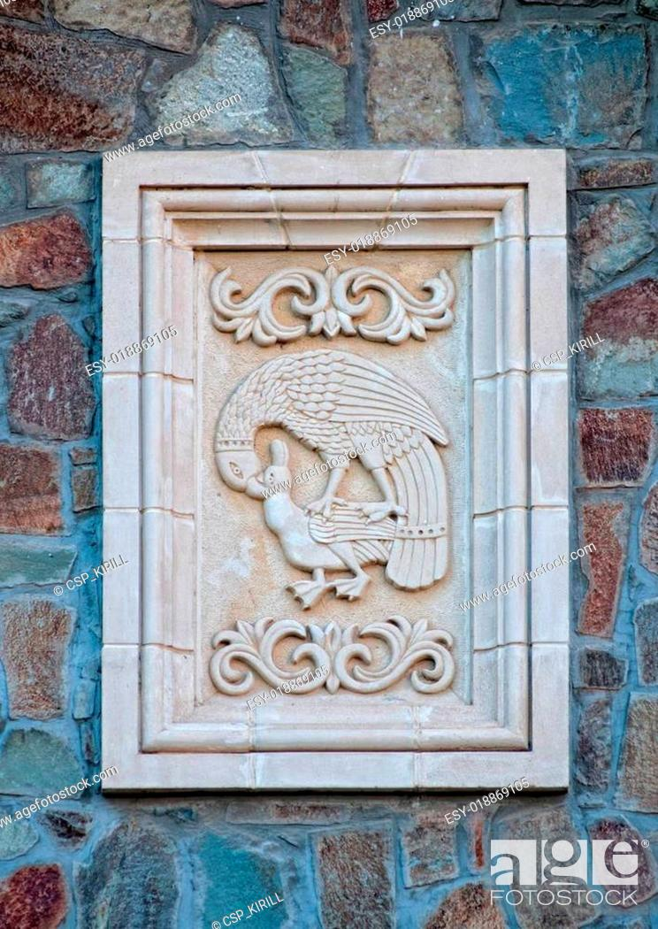 Stock Photo: Eagle hunting relief on wall of Kykkos monastery.