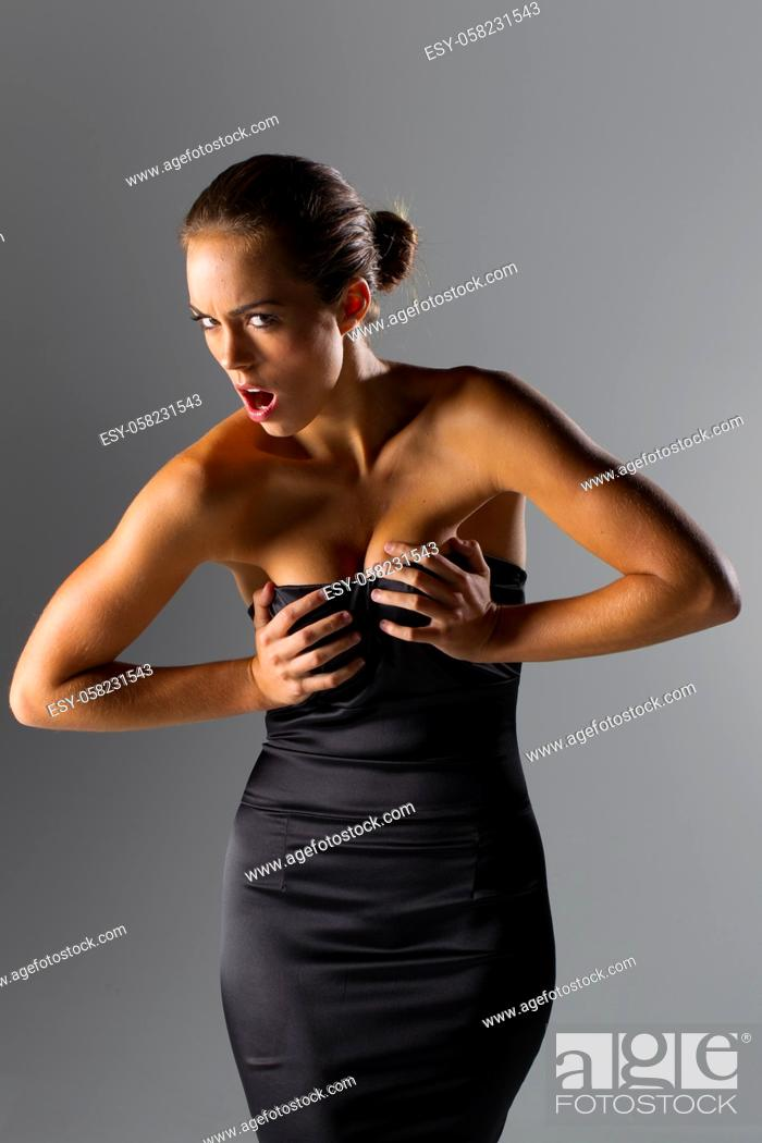 Stock Photo: A beautiful brunette model posing in a studio environment.