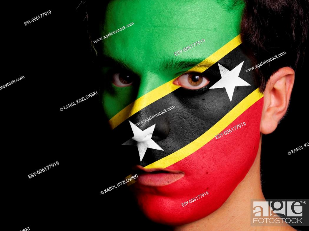 Photo de stock: Flag of Saint Kitts and Nevis Painted on a Face of a Young Man.