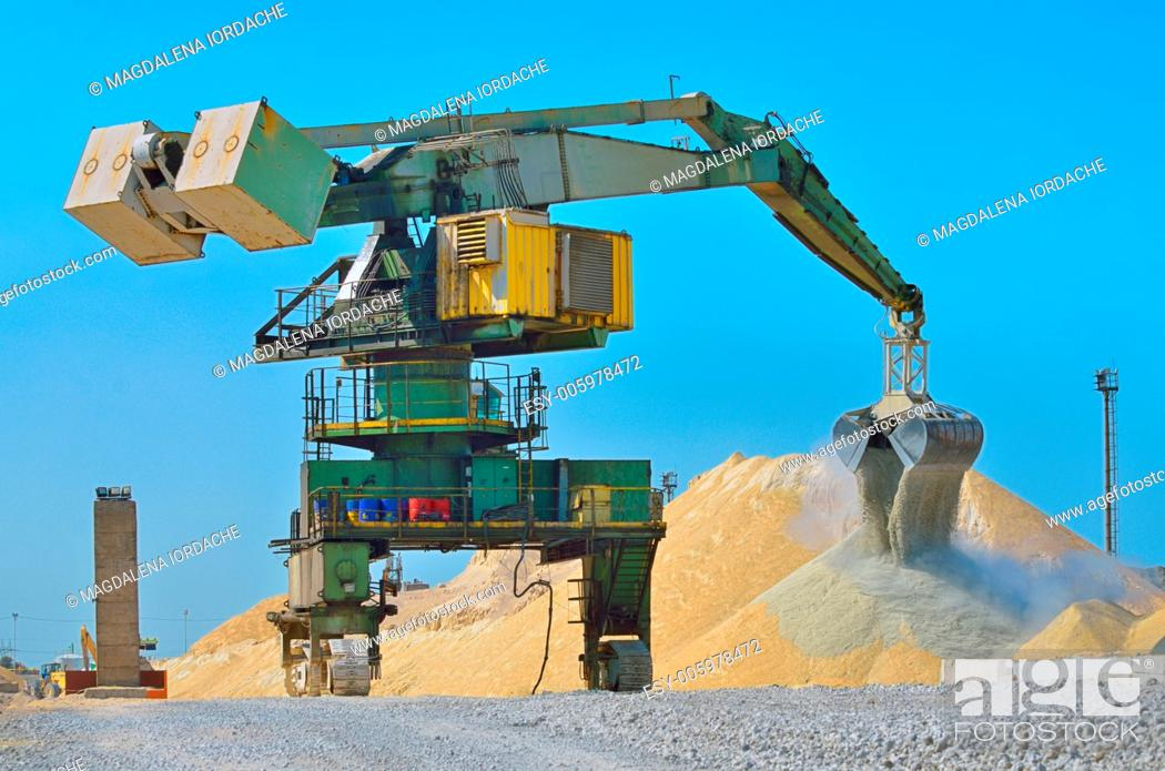 Stock Photo: Heavy excavator loader at soil moving works at construction.