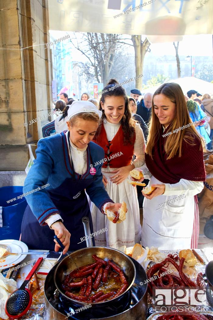 Stock Photo: Txistorra, Fried sausage, Feria de Santo Tomás, The feast of St. Thomas takes place on December 21. During this day San Sebastián is transformed into a rural.