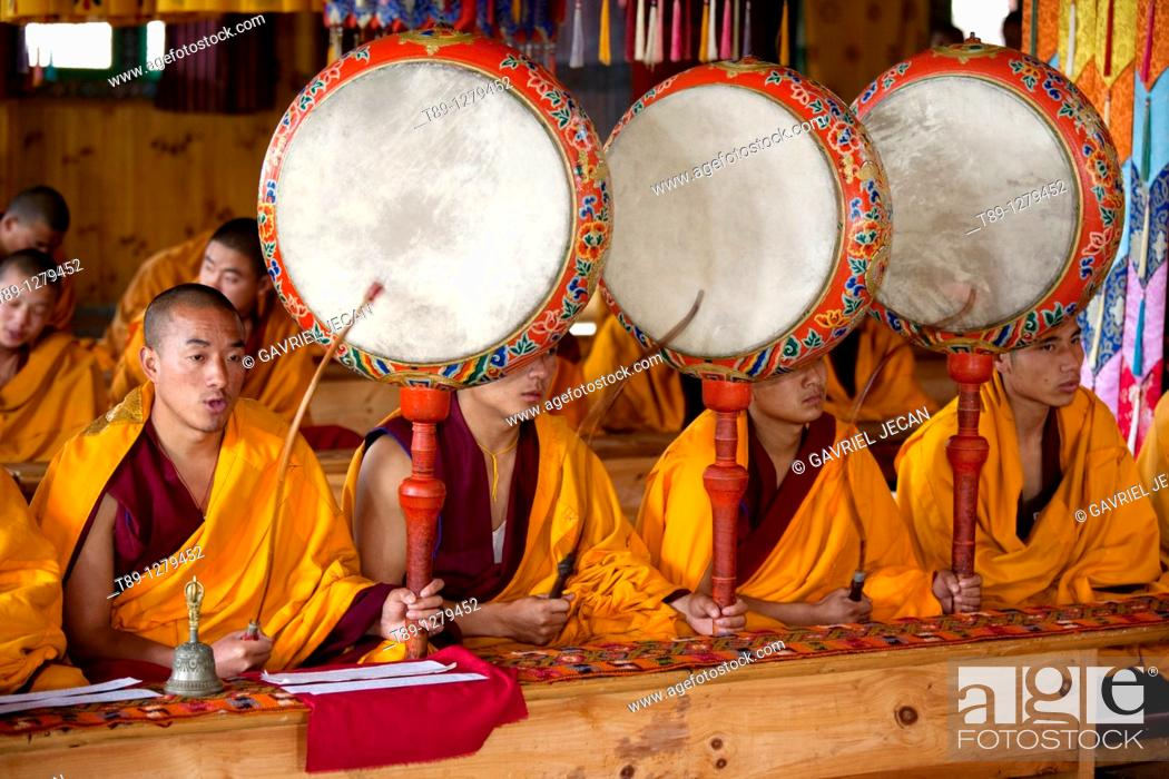 Stock Photo: Monks chanting in the temple.
