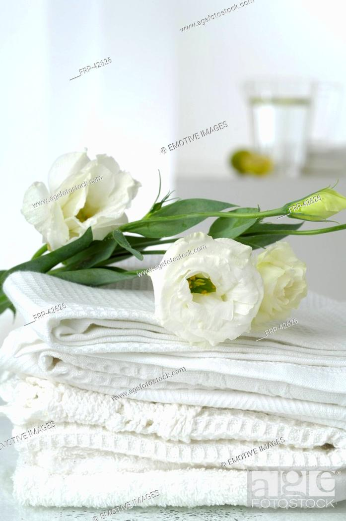 Stock Photo: Piqué towels decorated with lisianthus flowers.