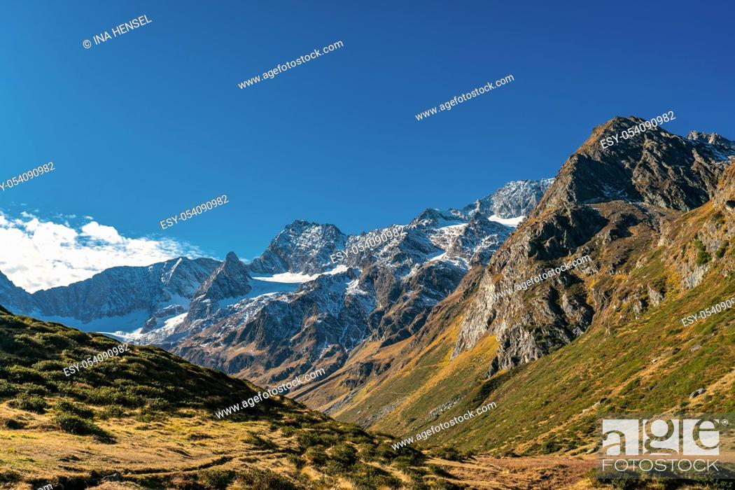 Stock Photo: Hiking path at Timmelsjoch and Texelgruppe nature park leading to the Seebersee lake with the alpine mountains in the background in a bright autumn day.