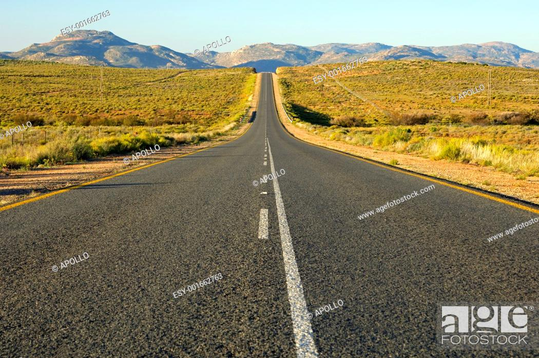 Stock Photo: Dead straight asphalt ribbon of the national road N7 near Springbok in Northern direction towards the border with Namibia, South Africa.