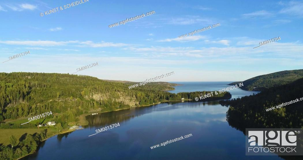 Stock Photo: Aerial shot of a glassy bay of the Baltic Sea at the Swedish High Coast (Höga Kusten)on a sunny summer day.