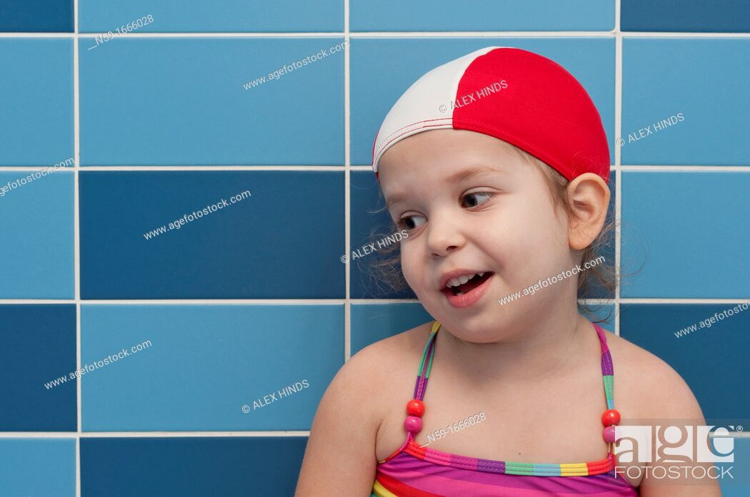 Stock Photo: Three year old girl at swimming pool ready for a swimming lesson.