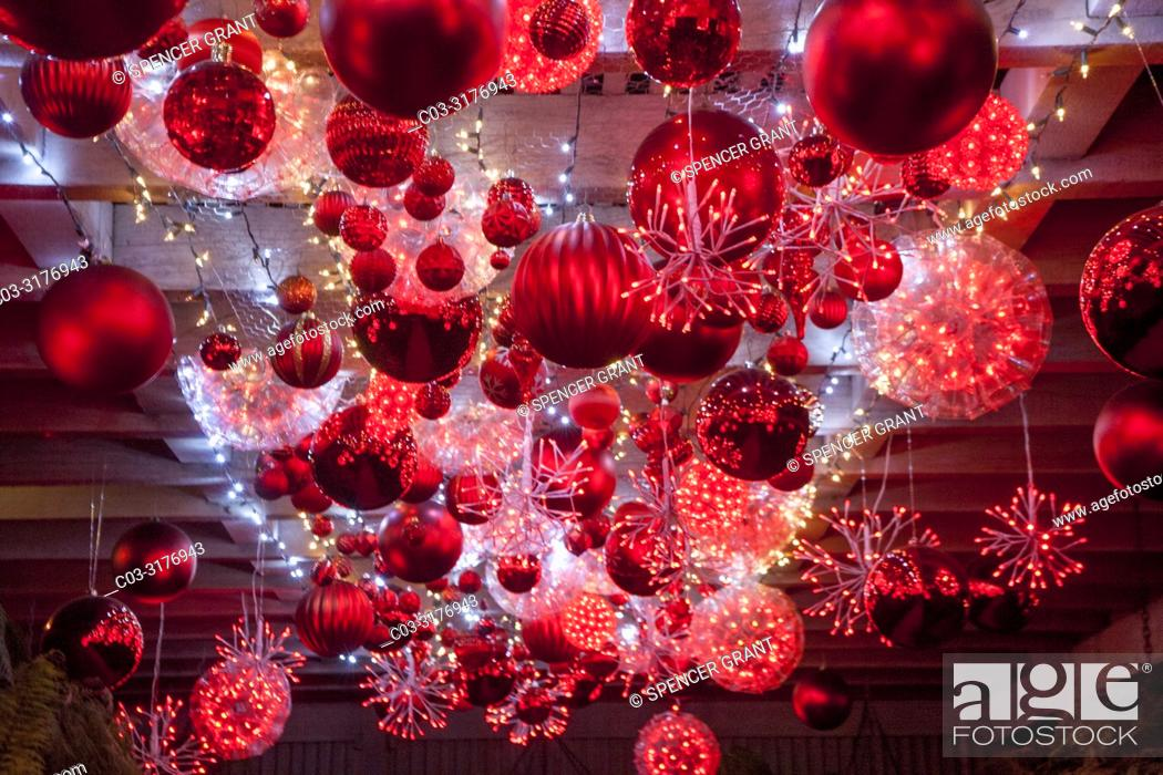 Stock Photo: Huge Christmas tree balls shimmer in the ruby glow display in Newport Beach, CA. .