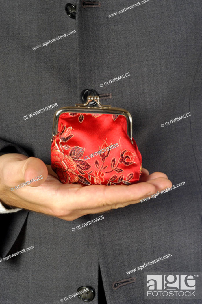 Stock Photo: Mid section view of a businessman holding a change purse.