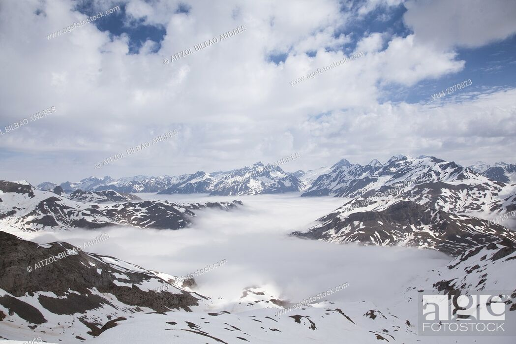 Stock Photo: The clouds go up from the valley, nice views from Cuyalaret summit, Pyrenees.