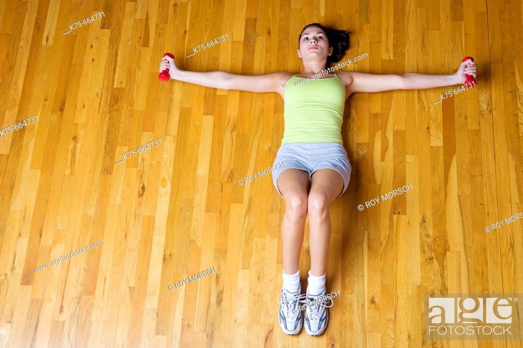 Stock Photo: floor exercise with weights.