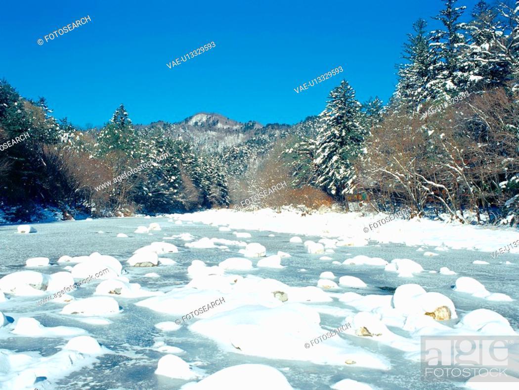 Stock Photo: snow, valley, water, stone, stream, tree, nature.